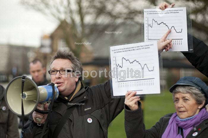 Tim Woodcock, Greenwich NUT and Chair of Greenwich and Bexley Trades Council with graphs showing the low cost of current public debt and borrowing in comparison with earlier periods. March against proposed cuts in spending by Greenwich Council, Woolwich, London. - Philip Wolmuth - 2011-02-12
