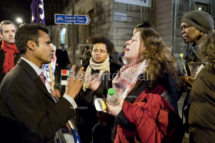 Council leader Nasim Ali talks to users of children's centres,youth clubs, and day centres for people with learning difficulties. (all threatened with closure) protest outside Camden Town Hall before a council Cabinet budget-setting meeting. - Philip Wolmuth - 2011-02-23