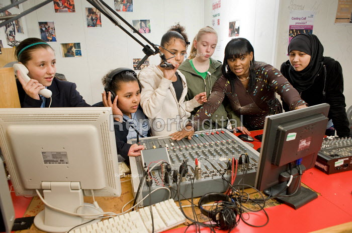 Youth worker Carol Archibald with an after-school group in the Avenues FM radio studio at the New Avenues Youth Club, Queen's Park. West London. - Philip Wolmuth - 2010-01-28