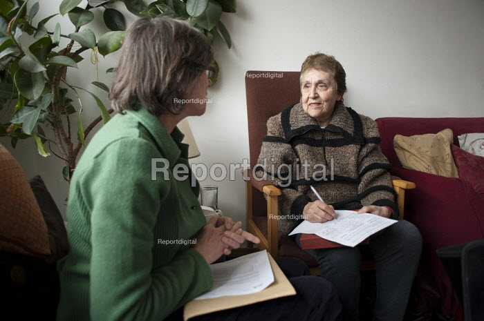 Alicia Nicolas, who has suffered a stroke and is unable to leave her flat unaided, with the co-ordinator of an Age Concern Camden's Good Neighbours Scheme, which organises regular weekly visits from a volunteer. - Philip Wolmuth - 2011-02-02