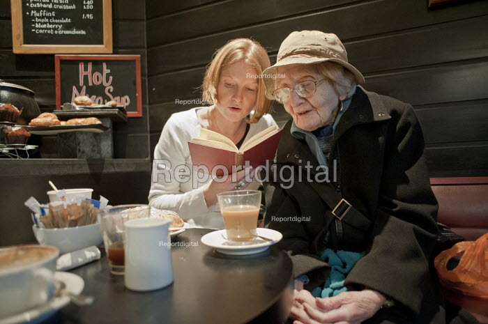 96 year-old Vivien Pixner suffers from age-related macular degeneration and can no longer read, or leave her flat without help. Through Age Concern Camden's Good Neighbours Scheme, volunteer Debbie Lythe, a secondary school teacher, visits once a week to accompany her to a local cafe and to read and discuss her chosen books. The scheme is threatened with closure following government cuts to Camden Council's funding. - Philip Wolmuth - 2011-03-01