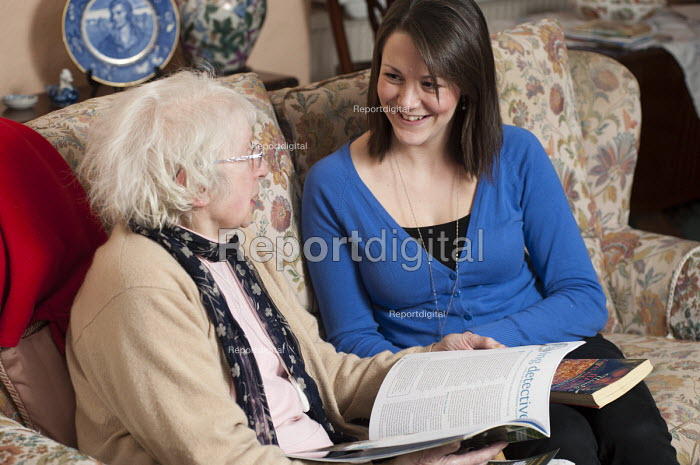 91 year-old Doreen Dickson-Cohen with volunteer Rachel McGinnety, who visits once a week through Age Concern Camden's Good Neighbours Scheme, which may close as a result of government cuts to Camden Council's funding. - Philip Wolmuth - 2011-03-03