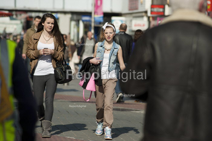 Two teenage girls walk in the High Street, Southend, Essex. - Philip Wolmuth - 2011-03-12