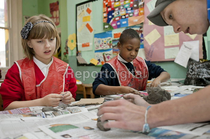 Moulding clay at an After-school club at the Winchester Project, Swiss Cottage, which may close due to cuts to Camden Council's funding. - Philip Wolmuth - 2011-03-14