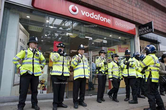Police protect Vodafone store in Oxford Street. TUC March for the Alternative, protest against public spending cuts, London - Philip Wolmuth - 2011-03-26