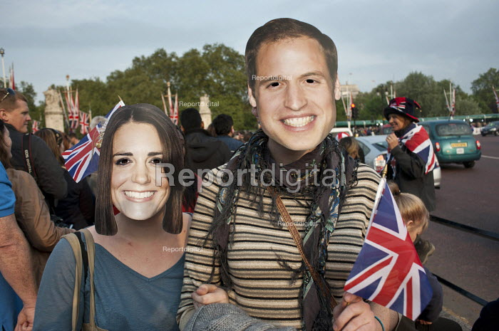 Spectators with face masks outside Buckingham Palace on the eve of the Royal Wedding. - Philip Wolmuth - 2011-04-28