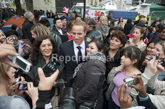 A Prince William lookalike mixes with the crowds outside Westminster Abbey on the eve of the Royal Wedding. - Philip Wolmuth - 2011-04-28