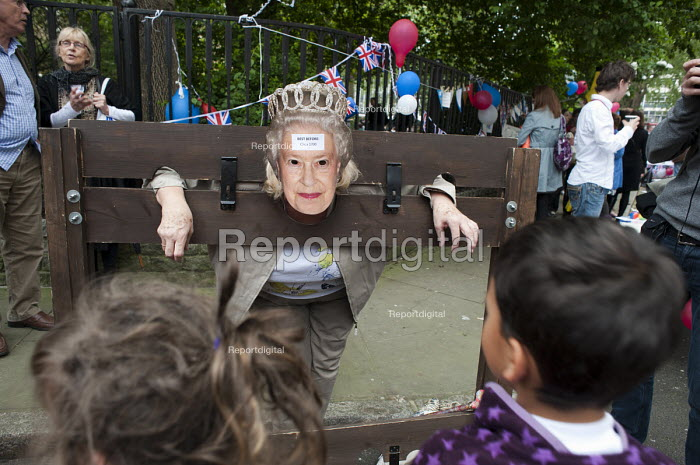 The Queen in the stocks. Not the Royal Wedding street partry organised by Republic, which wants to abolish the Monarchy. Red Lion Square, London. - Philip Wolmuth - 2011-04-29