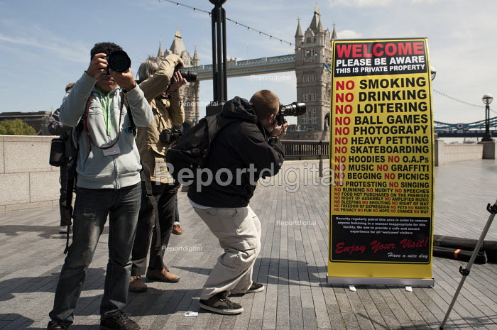 "Photographers protest on the Thames Footpath outside City Hall to highlight restrictions on photography by security guards, and the privatisation of public space across London. Organised by the ""I'm a Photographer Not a Terrorist!"" campaign and supported by the NUJ London Photographers Branch. - Philip Wolmuth - 2011-05-03"