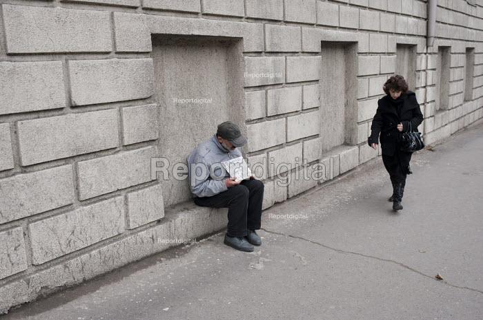 An elderly man begging in a street. Georgia - Philip Wolmuth - 2011-04-07