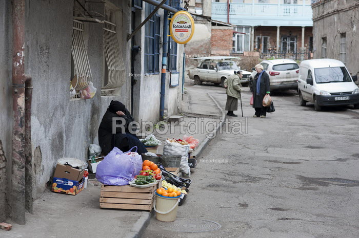 An elderly woman selling fruit and vegetables in the street. Georgia - Philip Wolmuth - 2011-04-07