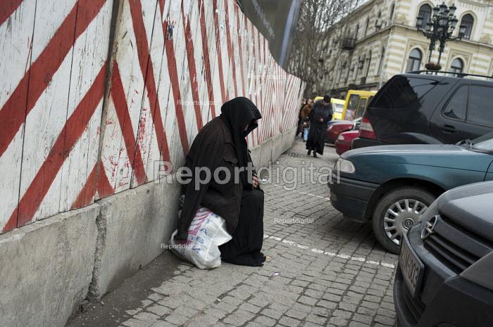 An elderly woman begs in a street in central Tbilisi, Georgia. Georgia - Philip Wolmuth - 2011-04-07
