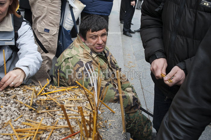 A war veteran begs at a memorial rally on the anniversary of the 1989 Soviet massacre of 20 hunger strikers outside the Parliament building in Tbilisi, Georgia. - Philip Wolmuth - 2011-04-09