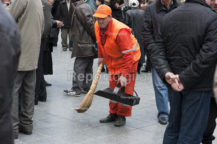A Municipal street cleaner sweeping the streets, Georgia. - Philip Wolmuth - 2011-04-09