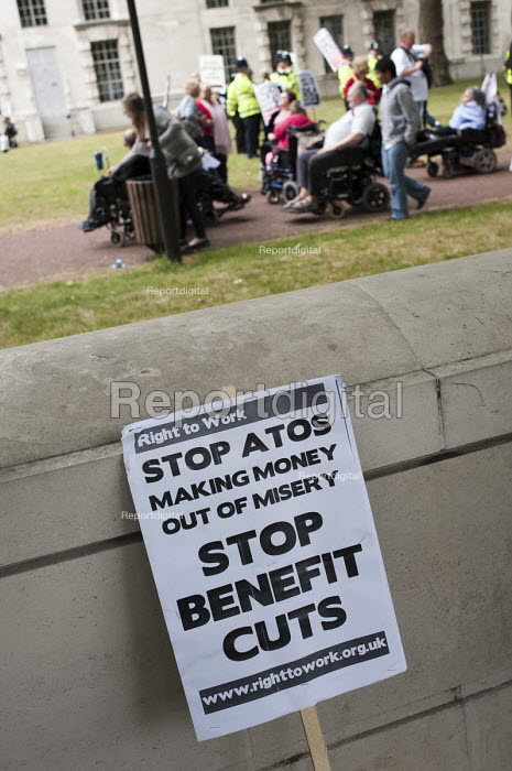 Stop ATOS, Stop Benefit cuts. The Hardest Hit. London march organised by the UK Disabled People's Council to protest at government cuts to disability benefits, allowances and services. - Philip Wolmuth - 2011-05-11