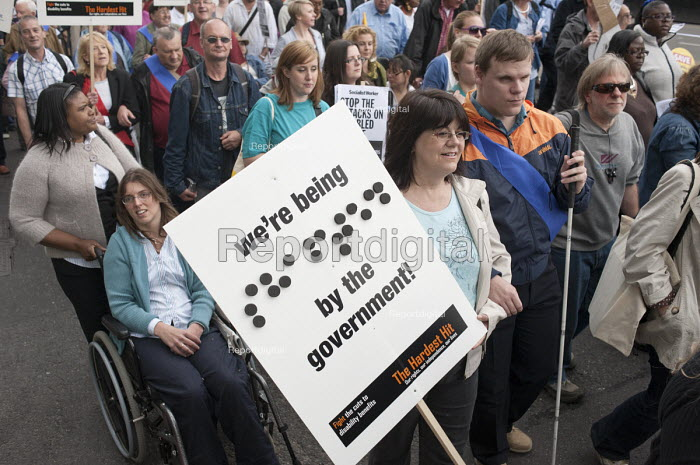 We're being shafted by the government!. Braille placard at The Hardest Hit London march organised by the UK Disabled People's Council to protest at government cuts to disability benefits, allowances and services. - Philip Wolmuth - 2011-05-11