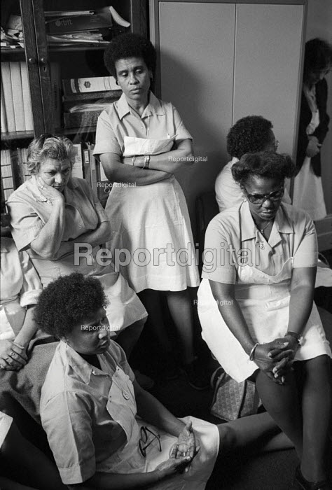 Domestic workers occupy the adminstration offices of St.Mary's Hospital, Harrow Road, London, in protest at the imposition of short-term contracts and the proposed closure of the hospital. - Philip Wolmuth - 1981-10-28