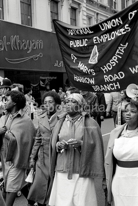 Workers at St.Mary's Hospital, Harrow Road, London, march in protest at the imposition of short-term contracts and the proposed closure of the hospital. - Philip Wolmuth - 1981-10-03