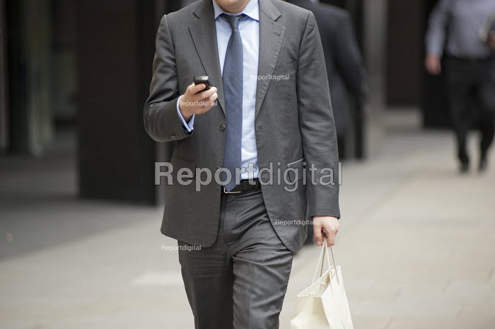 Man with a mobile phone outside Deutsche Bank, City of London. - Philip Wolmuth - 2011-06-21