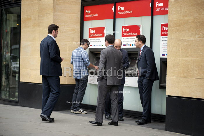 Free cash withdrawals. City workers use a cash machine outside Deutsche Bank, City of London. - Philip Wolmuth - 2011-06-21