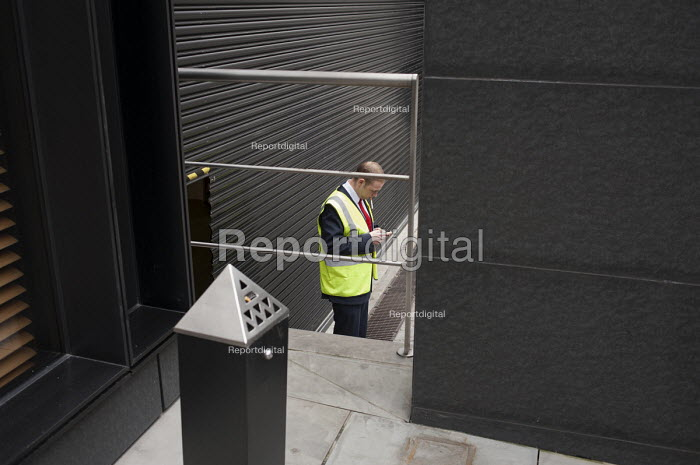 Security guard outside an office building, City of London. - Philip Wolmuth - 2011-06-21