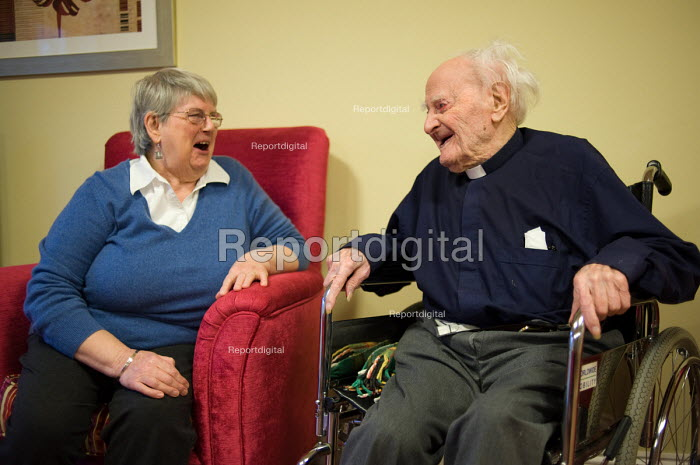 Resident representative June Roberts talks with Reverend Reg Dean, the oldest man in the UK (108), Waltham House Extra Care sheltered housing scheme, Winksworth, Derbyshire, run by Housing 21. - Philip Wolmuth - 2010-11-22