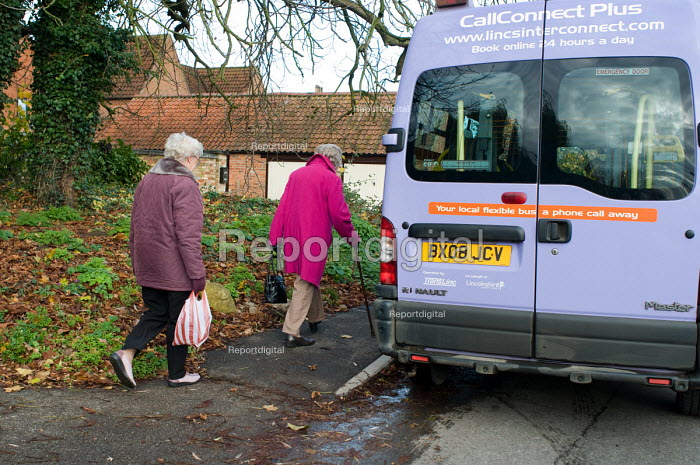 Two elderly women board a CallConnect bus-on-demand service in the village of Ewerby, Lincolnshire. - Philip Wolmuth - 2010-11-10