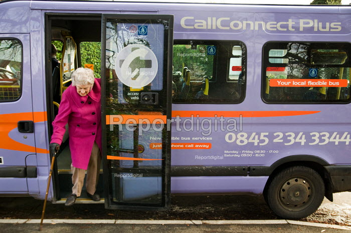 A passenger gets off a CallConnect bus-on-demand service in the village of Ewerby, Lincolnshire. - Philip Wolmuth - 2010-11-10