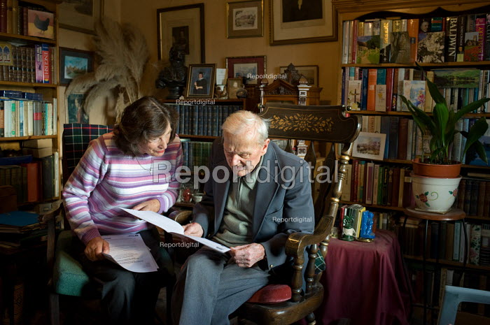 Age UK Norfolk Money Matters volunteer adviser with an eldertly client in his isolated cottage in Great Plumstead, Norwich. - Philip Wolmuth - 2010-11-18