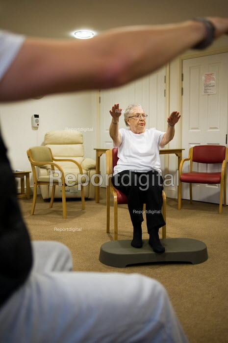 Chair-based exercise class at Esk Moors Lodge, Castleton, North Yorkshire, a sheltered housing scheme and 'extra care' centre run by Esk Moors Caring. - Philip Wolmuth - 2010-11-01