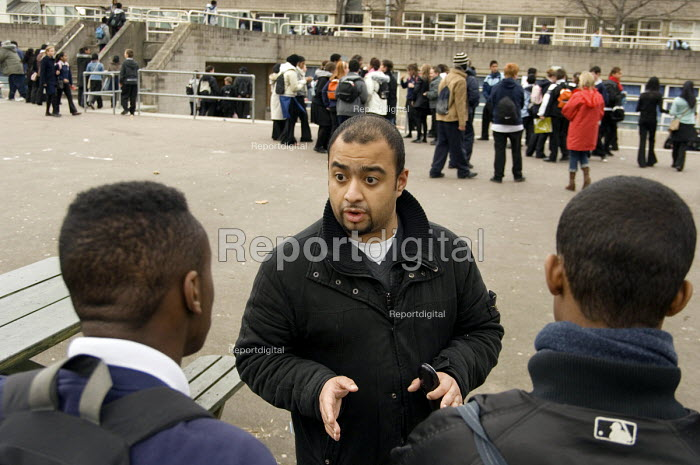 Jabir Uddin, Youth and Community Manager of the Extended School Programme at George Green Secondary School, Isle of Dogs, Tower Hamlets, deals with a playground confrontation. - Philip Wolmuth - 2006-12-14