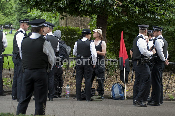 Police stop and search Black Block anarchists in Lincolns Inn Fields before a demonstration London - Philip Wolmuth - 2011-06-30