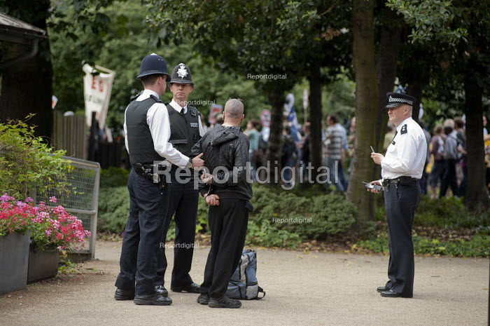 Police arrest a Black Block anarchist in Lincoln's Inn Fields before a demonstration by striking public sector worker over planned pension changes. - Philip Wolmuth - 2011-06-30