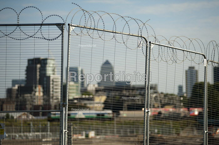 Temporary security fencing with barbed wire in the Olympic Park, Stratford, and Canary Wharf towers. - Philip Wolmuth - 2011-08-01
