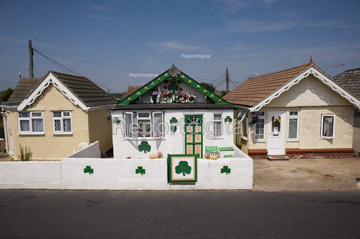 An Irish themed chalet with shamrocks (the shamrock is the national symbol of Ireland): well maintained bungalows on the Brooklands Estate in Jaywick Sands, close to Clacton-on-Sea. The estate's small wooden houses - many little bigger than beach huts - were originally built as holiday homes. - Philip Wolmuth - 2011-08-03