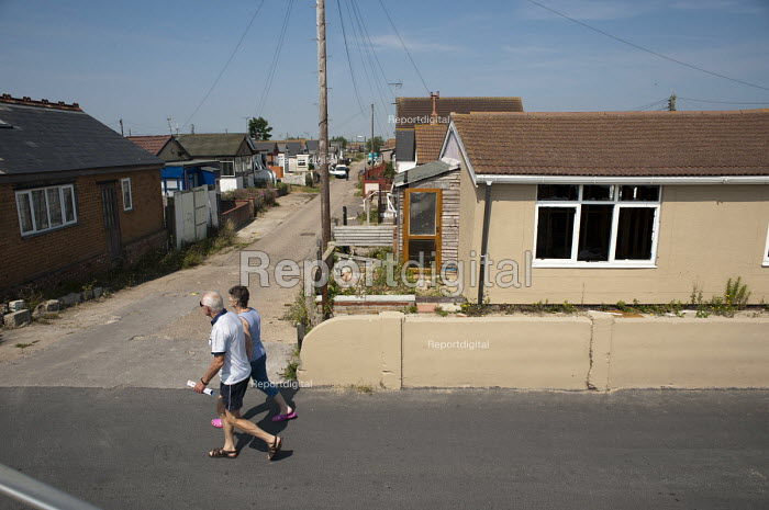 Vandalised bungalows on the Brooklands Estate in Jaywick Sands, close to the Essex resort of Clacton-on-Sea. The estate's small wooden houses - many little bigger than beach huts - were originally built as holiday homes. Brooklands is the most deprived ward in the UK, according to the latest Indices of Multiple Deprivation. - Philip Wolmuth - 2011-08-03