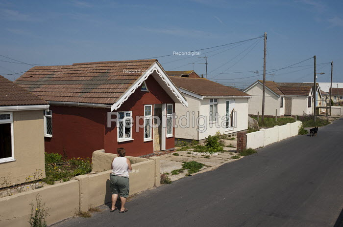 Vandalised bungalows on the Brooklands Estate in Jaywick Sands, close to Clacton-on-Sea. The estate's small wooden houses - many little bigger than beach huts - were originally built as holiday homes. Brooklands is the most deprived ward in the UK, according to the latest Indices of Multiple Deprivation. - Philip Wolmuth - 2011-08-03