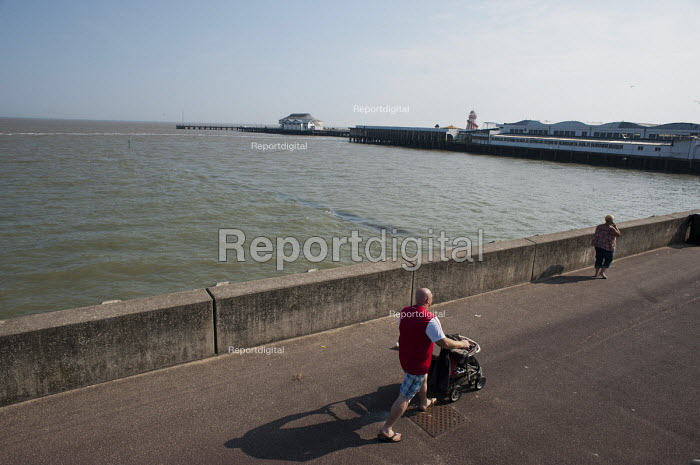 Farther pushing a pushchair, Clacton pier, Clacton-on-Sea, Essex. - Philip Wolmuth - 2011-08-03