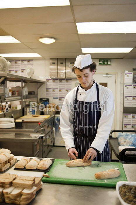 Apprentice cook at the Holiday Inn hotel, Bloomsbury, London. Baking bread loaves. - Philip Wolmuth - 2011-02-21