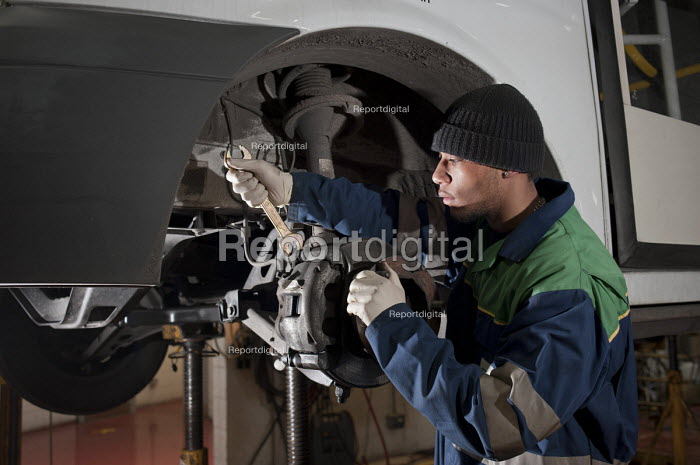 Apprentice vehicle mechanic at Camden Transport Services. Renewing brakes. - Philip Wolmuth - 2011-03-01