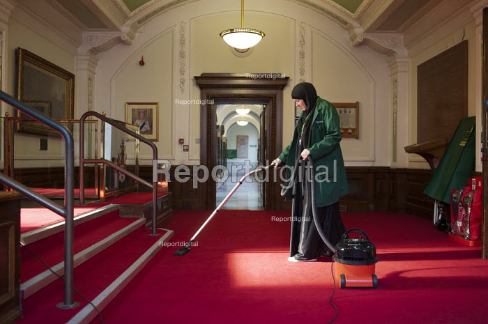 Cleaner on an early morning shift at Islington Town Hall. The 130 cleaners of the borough's 70 municipal buildings are now directly employed by the local authority, following 10 years with private contractor Kier. - Philip Wolmuth - 2011-06-02