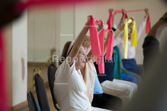 A chair-based keep fit exercise class at Swiss Cottage Community Centre. London - Philip Wolmuth - 2011-08-10