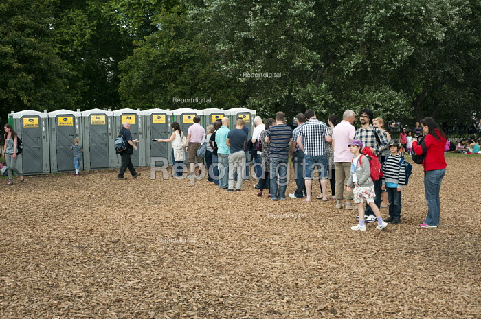 Visitors to the London 2012 Olympic Games Live Site in Hyde Park queuing for the use of the portable toilets. - Philip Wolmuth - 2012-08-08