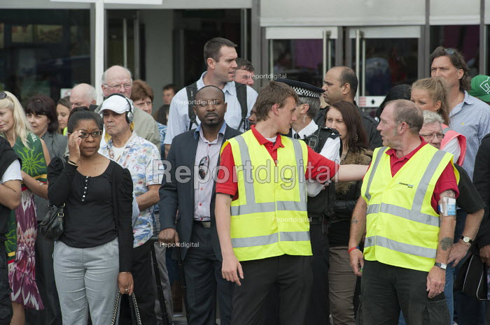 Stewards employed by private contractor McKenzie Arnold Security on duty at a road crossing in Stratford during the London 2012 Olympic Games. - Philip Wolmuth - 2012-08-08