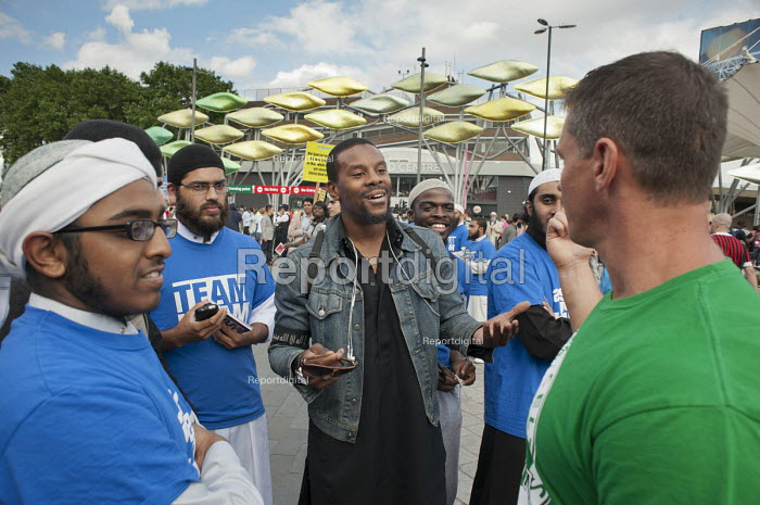 Members of Team Islam talking to local residents and visitors to the Olympic Park outside Stratford station during the London 2012 Olympic Games. - Philip Wolmuth - 2012-08-08