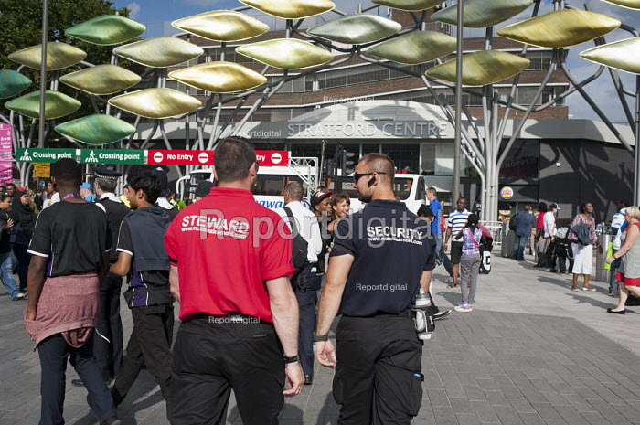 A steward and a security guard employed by private contractor McKenzie Arnold Security on duty in Stratford during the London 2012 Olympic Games. - Philip Wolmuth - 2012-08-08