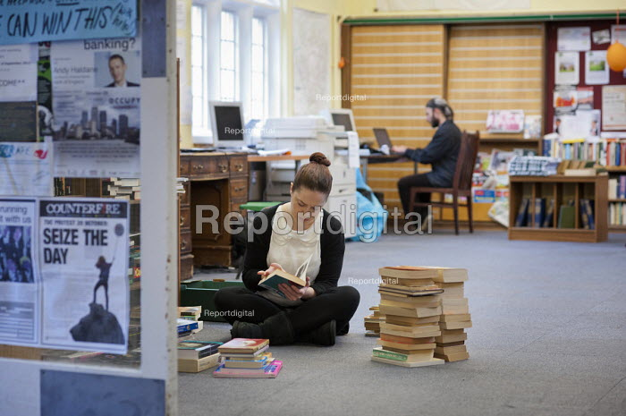 A volunteer librarian at Friern Barnet library, which has been restocked and reopened as The People's Library and community hub by activists and local residents. - Philip Wolmuth - 2012-10-23