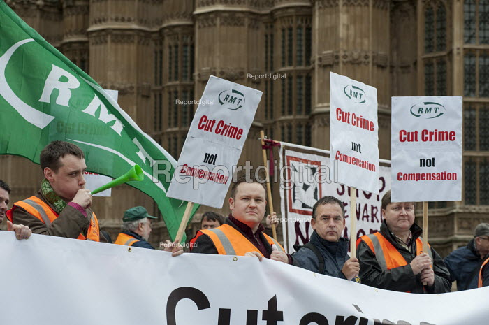 RMT and CWU members demonstrate outside parliament in protest at government plans to cut payments to the victims of violent crime through the Criminal Injuries Compensation Scheme. - Philip Wolmuth - 2012-11-12