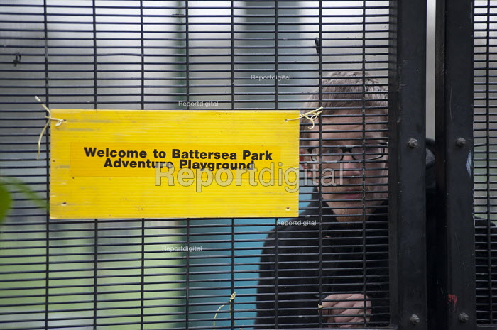 An Occupy London activist inside the now locked Battersea Park adventure playground. Activists and local residents oppose Wandsworth Council plans to demolish the playground, and replace it with conventional play equipment which will need less supervision. - Philip Wolmuth - 2013-01-08