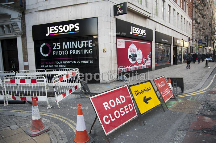 Closed down Jessops photographic equipment store in New Oxford Street, central London, asthe company went into administration. Road closed and diversion signs. - Philip Wolmuth - 2013-01-17